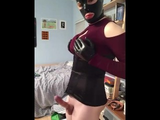 Latex Lola playing with her cock