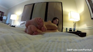 Dani Daniels teases the camera with her cute feet