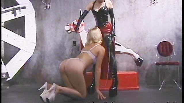 Erotic leather bondage - Hot blonde licks the leather boots of her ravishing domina