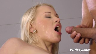 Submissive blonde smiles as I piss all over her beautiful face and body