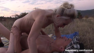 Blonde mature sucks & fucks outdoors