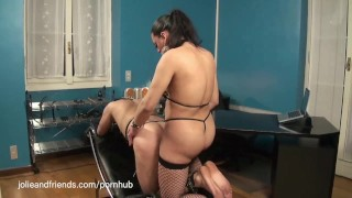 Tranny having fun with a slave wearing latex and getting whipped and fucked porno