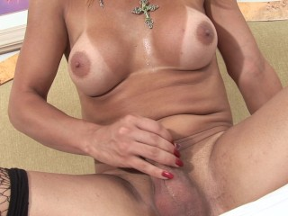 Blonde shemale Adriela Vendromine shows amazing body and jerks off
