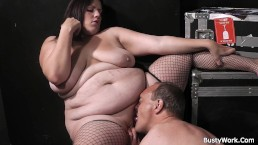 Fat ass plumper in fishnets rides boss cock