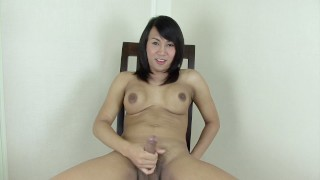 Sexy ladyboy Ning jerks off and cums all over herself