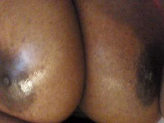 Huge ebony Oily boobs