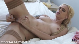 Blonde babe enjoying masturbation in nude stockings