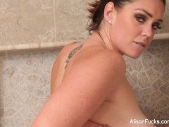 Alison toys herself to completion in a giant steamy shower