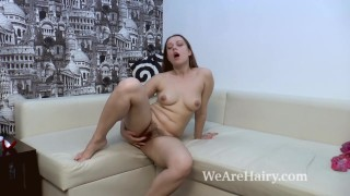 Jia strips naked and masturbates on her couch