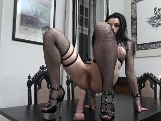 Slutty Goth rides and sucks her Dildo…