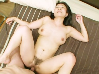 Horny Japanese cougar with nice natural tits is ready for sex
