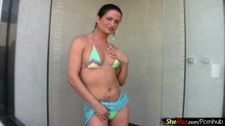 Bikini tgirl beauty is tugging good sized cock in the shower