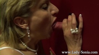 Blonde milf Lady Sonia sucking big dick on the glory hole Tits licking