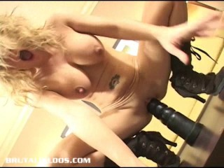 Busty blonde bounces and nuts on a massive black dildo