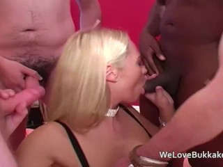 Alexis May is circled by hard cocks which she sucks off