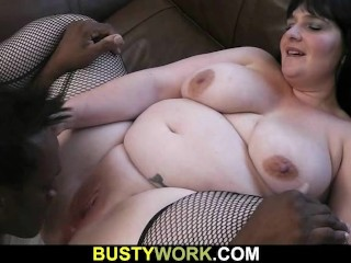 Plumper in fishnets rides black meat