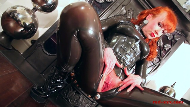 Rubbing wet juicy pussy Red lubes up her latex catsuit and rubs her juicy wet pussy
