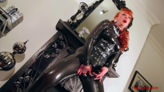 Red lubes up her latex catsuit and rubs her juicy wet pussy  finger fucking masturbation british uk ginger boots redhead old mom milf latex mother ukmilf red xxx