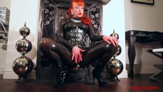 Red lubes up her latex catsuit and rubs her juicy wet pussy Stockings raven
