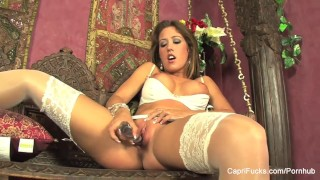 Capri Cavanni gets herself off with a glass dildo