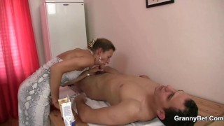 Old woman massage his cock