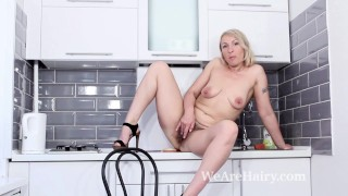 Luiza M strips naked and masturbates in a kitchen