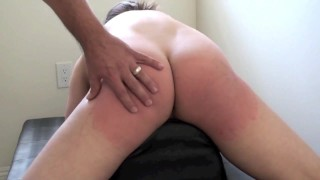 Another girl`s ass punished with a whip and paddle