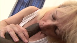Horny blonde granny wakes up black guy for sex