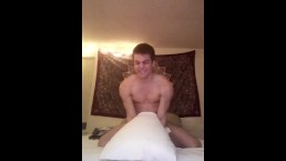 Horny guy gets off to pillow humping