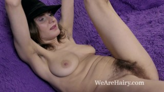 Couch her and pique strips on masturbates dame teasing hairy