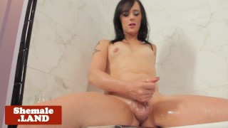 Tattooed solo tgirl jerking cock in bathroom Bigtits stockings