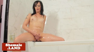 Tattooed solo tgirl jerking cock in bathroom