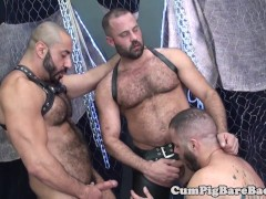 Suspended bear jerks out cum in bareback trio