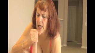 mature woman handjob cum