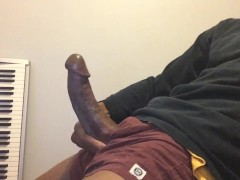BIG LATINO COCK STROKES AND CUMS ALL OVER HIMSELF.