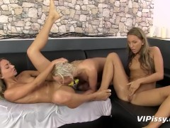Gorgeous girls masturbate together after getting soaked in piss
