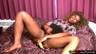 Curly haired ebony shemale slips banana in her ass and jerks