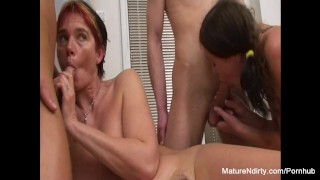 Granny and babe service two cocks in a foursome