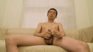 Shy Japanese dude shows off his body and jerks off