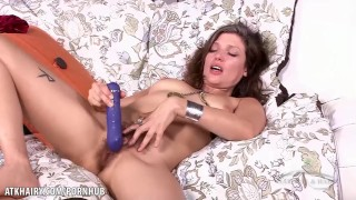 Tristessa strokes her hairy pussy with a vibrator