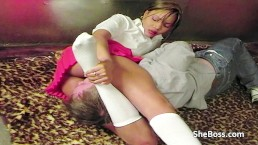 Black girl in college outfit facesitting her white slave