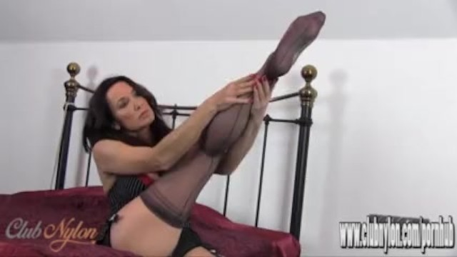 Silky smooth sexy legs Hot milf slips her sexy long legs inside new pair of silky nylon stockings