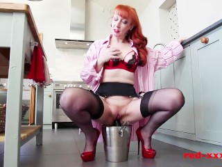 Kinky milf redhead fucks a bottle of champagne then a dildo