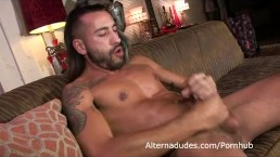long haired stud jacks his hairy curvy cock