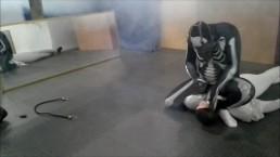 gasmasked skeleton defeats his white dummy