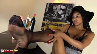 Horny Ebony Girl gives footjob and masturbates in stockings