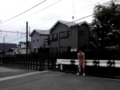 Japanese boy flashing to train.