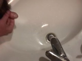 jerking off and cumming in the sink