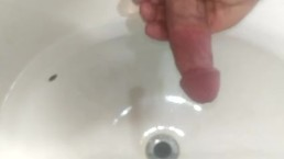 Jacking off into the sink