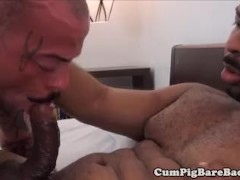 Muscular black barebacking inked hunk
